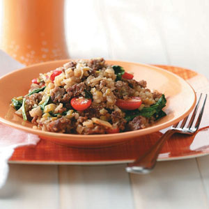 Sausage Risotto with Spinach and Tomatoes Recipe